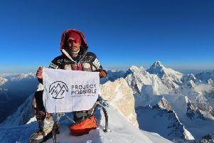 "Nepali climber Nirmal 'Nims' Purja standing at the summit of Gasherbrum II on 18 July 2019. The mountaineer went on to smash the speed record for summiting the world's 14 highest peaks, racing up all the ""8000ers"" in just six months and six days PIC: AFP via Getty Images"