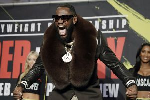 Flamboyant in his fur-trimmed overcoat, Deontay Wilder arrives for a meeting with the media ahead of his fight with Tyson Fury. Picture: AP.