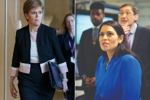 Home Secretary Priti Patel (right) defended the plans from critics like Nicola Sturgeon. Picture: PA