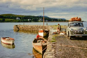 Playing on the jetty: two young Whatley boys get ready to sail to Pabay from the Skye mainland. PIC: Whatley Collection.