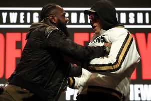 Deontay Wilder and Tyson Fury confront each other on stage during the press conference at the MGM Grand Garden Arena ahead of Saturday's world title fight. Picture: PA.