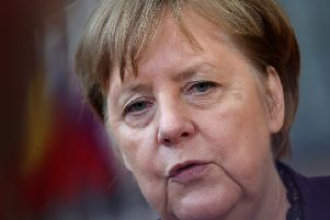 Chancellor Angela Merkel warned of the poison of racism after a far-right terror attack on people in Hanau, Germany (Picture: Aris Oikonomou/AFP via Getty Images)