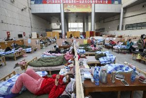 Patients rest at a temporary hospital at Tazihu Gymnasium in Wuhan in central China's Hubei province. Picture: Chinatopix/AP