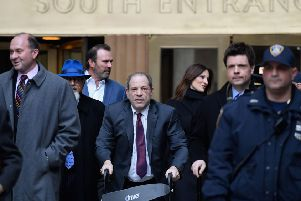 Harvey Weinstein uses a walker as he leaves Manhattan Supreme Court on the third day of jury deliberations in his trial (Picture: Angela Weiss/AFP via Getty Images)