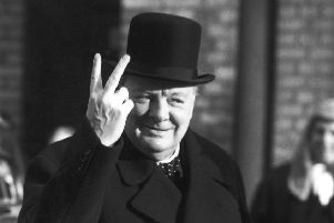 Winston Churchill gives a 'V for Victory' salute in November 1942 (Picture: Reg Speller/Getty Images)
