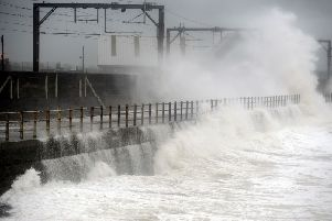 Waves hit trainlines in Saltcoats. Picture: John Devlin