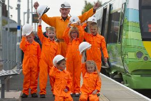 Kids from St Andrews Primary school in Gorebridge greet the train as it arrives in to Newtongrange station. Picture: Lesley Martin