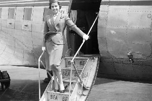 BEA air hostess Jill Morgan prepares to welcome passengers to a flight departing from Turnhouse in June 1955. Picture: TSPL
