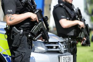 Armed police will remain at the Scottish Parliament
