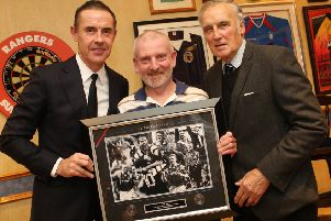 Rangers legends David Weir and Ronnie Mackinnon with a lucky fan, who secured some of the Rangers' memorabilia which was up for raffle.