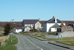 The Garrabost village, with the Memorial Garden visible between the churches. ''Picture by Sandie Maciver of SandiePhotos