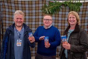 Essence of Harris managing director Jamie McGowan (centre) with HebCelt's finance director Martin Jones and festival director Caroline Maclennan.