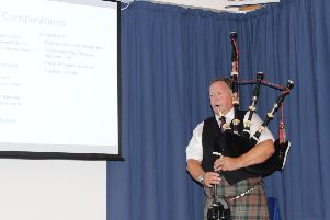 Roddy Macleod, Director of the National Piping Centre and technical adviser on the book, playing a piobaireachd at the launch.