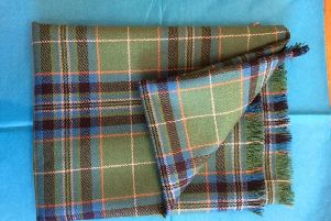 The tartan was very generously donated to the trust by Co-chomunn Eirisgeidh (Eriskay Community Co-operative) who are the only people allowed to authorise the use of the tartan.  The design by Brian Wilton is based on the Royal Stewart check ' a nod to Bonnie Prince Charlie landing on the island from France in the mid-18th century.