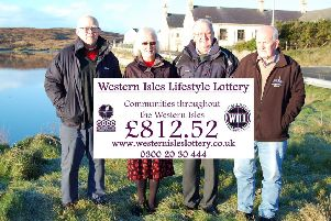 The Harris Historical Society group receive a much needed boost from the local lottery to help them achieve their aims.