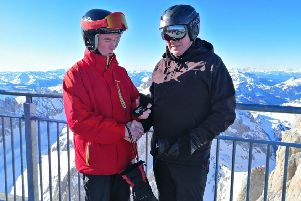 Captain Tim Martin (right) receiving the Cadet Force Medal during his skiing trip to Italy by the Battalion's Commandant Col Cassidy.