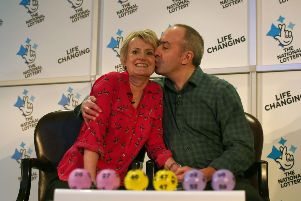 David and Carol Martin, a husband and wife from Hawick, celebrate at the Dalmahoy Hotel & Country Club in Edinburgh after winning half of the historic �66 million Lotto jackpot.
