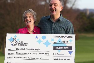 David and Carol Martin, a husband and wife from Hawick in the Scottish Borders, celebrate at the Dalmahoy Hotel & Country Club in Edinburgh after winning half of the historic �66 million Lotto jackpot. PRESS ASSOCIATION Photo. Picture date: Wednesday January 13, 2016. The rollover Lotto prize was split between two tickets that had all six winning numbers from Saturday's draw - 26, 27, 46, 47, 52 and 58. See PA story LOTTERY Winners. Photo credit should read: Andrew Milligan/PA Wire