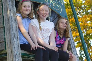 Enjoying Wednesday's sunshine in Jedburgh are Robyn Wright, Caitlin Armstrong and Kelly Morris.