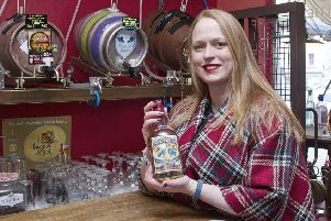 Audrey Anderson with their new haggis gin.