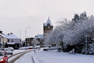 Galashiels' town clock and Bank Street Gardens in the snow.