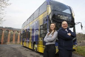 Lee Young and Julianne Smith with Borders Buses' Doddie Weir bus.