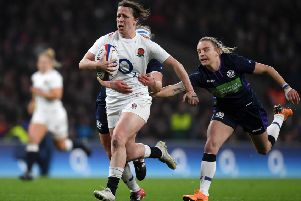 Katy Daley-Mclean of England breaks away from Scotland's Border duo of Lana Skeldon (hidden) and Chloe Rollie at Twickenham on Saturday (photo by Shaun Botterill/Getty Images).
