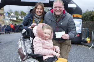 Steven and June Russell with their daughter Maia from Ancrum. The Rally presented a cheque for �250 towards a new wheelchair for Maia, this brought them to the threshold of �5000 for the new wheelchair.