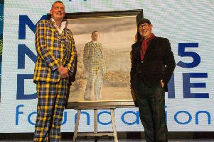 Rugby legend Doddie Weir and painter Gerard Burns with the portrait. Photo: Veronica Sanchis Bencomo