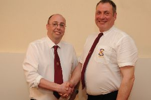 Darren Miller is congratulated on his appointment by Weavers deacon Mick Quinn.