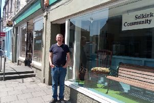 Barry Sutton from Selkirk Community Shed outside its news display at the old post office in High Street.