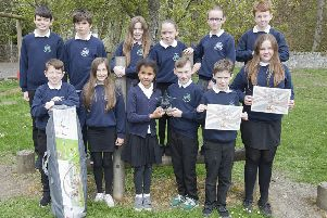 Heriot Primary School pupils with their award and gazebo.