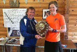 Maggie Connacher, vice-president of Scottish Hockey presents the victory shield to Laura McLean, of Fjordhus Reivers and the  captain of South Ladies Masters, on winning the Scottish Hockey Ladies Masters Inter District Tournament.