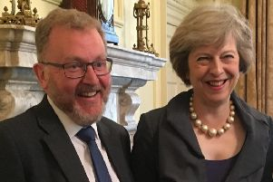 Happier times: David Mundell with Theresa May.