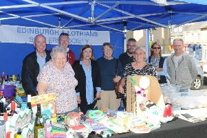 Members of Edinburgh and Lothian Souters' Society at their stall at the farmers' market in Selkirk Market Place on Saturday morning. Pictured, from left, are Jim Jackson (society president), Margo Craig, David Young, Brenda Haldane, Margaret Foggo, Ex-Standard Bearer Steven Squance, Arlene Craig, May Stark and Rob Robinson.