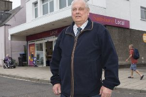 Selkirkshire councillor Gordon Edgar outside the Sainsbury's Local store in High Street.