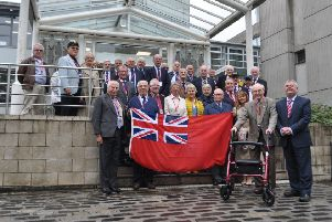 Merchant Navy personnel gather at Scottish Borders Council headquarters for Merchant Navy Day last year.