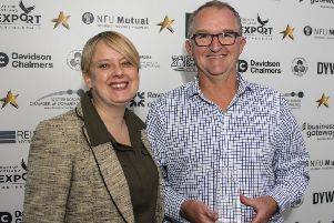 Last year's Innovation in Business winner, Andy Smith of Agenor Technology, with category sponsor representative, council leader Shona Haslam.