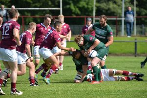 Hawick's Matt Carryer, with the ball (and an ex-Gala player) about to feel the weight of a tackle by Martin Christie (picture by Alwyn Johnston).