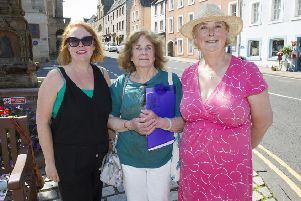 Gina Braydon, Jane Neagle and Georgiana Craster with a petition to keep the Jedburgh library where it is.