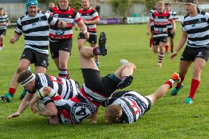 Tough tackling between Kelso, in black and white stripes, and Stirling Wolves (picture by Gavin Horsburgh)