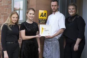 Alasdair and Ashley Wilkie, owners of Capon Tree Town House, with staff Beth Thomson, left, and Rhianne Miller, right, celebrating their fir st AA Rosette.