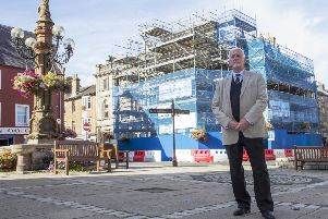 Jedburgh councillor Jim Brown at the scaffolding-clad building in Market Place.