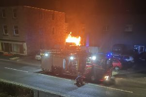 Fire crews battle a fire outside Bongate Garage, Jedburgh. Photo: Kym Hall.