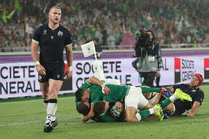 YOKOHAMA, JAPAN - SEPTEMBER 22: Ireland wing Andrew Conway scores the 4th Ireland try despite the attentions of Grant Gilchrist as Stuart Hogg reacts during the Rugby World Cup 2019 Group A game between Ireland and Scotland  (Photo by Stu Forster/Getty Images)