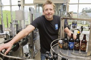 John Henderson at Born in the Borders with beers of his featured in the latest Aldi Scottish beer festival.