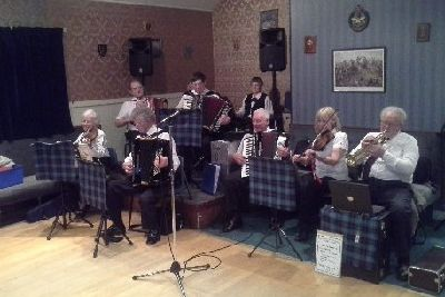 Accordion group donate thousands to local charities