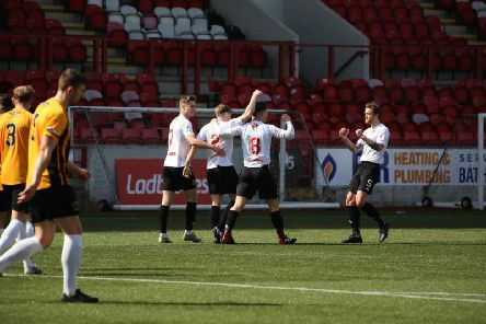 Berwick players look on as Clyde celebrate during their 5-0 success