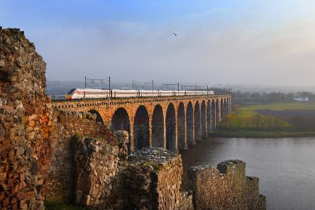 An Azuma train passes over the Royal Border Bridge at Berwick.