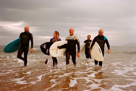 Surf board maker Jason Burnett stars in the ad, along with his fellow surfer friends at Pease Bay.